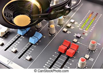 Headphones on mixer in studio - headphones with glitter on...