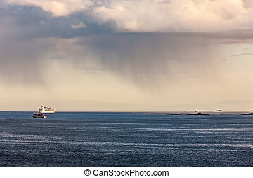 rain clouds over the sea - landscape with rain clouds over...