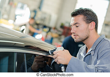 man working on a car body