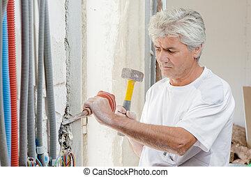 Chiseling away at a wall