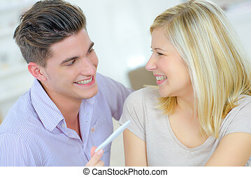 Happy couple holding pregnancy tester