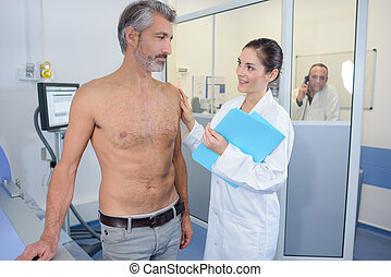 Nurse reassuring male patient