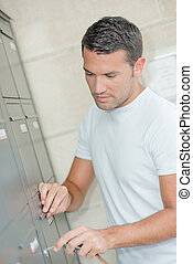 Man checking his letter box