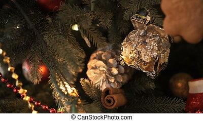 Christmas decorations hang on the Christmas tree.