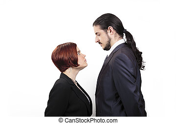 Stand off between a male and female partner with the shorter...