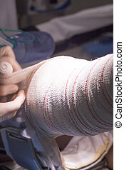 Bandaging post knee surgery - Nurse bandaging after Surgical...