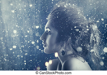 Winter beauty. Fantastic seasonal female portrait with abstract background
