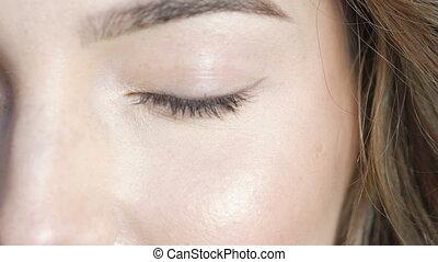 Close up female eye blinking. Slowly - Close up female eye...