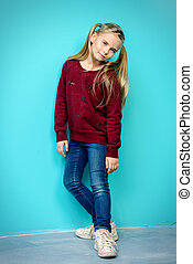 casual style clothes - Kid's fashion. Full length portrait...