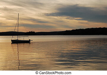 sailboat on lake wentworth - sailboat at sunset on lake...