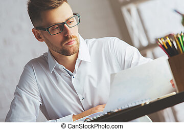 Attractive man with document - Portrait of attractive...