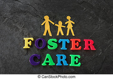 Foster care family - Paper family with Foster Care letters