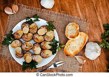 Escargots de Bourgogne - Snails with herbs butter, gourmet...