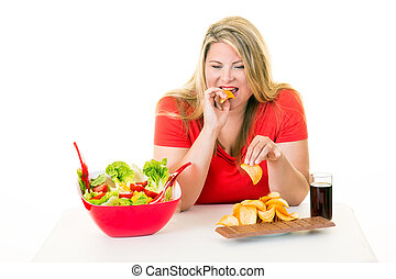 Overweight woman eating unhealthy junk food - Overweight...