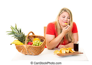 Unhealthy woman eating junk food rather than fruit -...