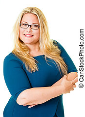 Smiling plus sized blond executive in blue dress stands with...