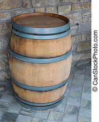 wooden barrel on  marble tile floor, stone wall  in background