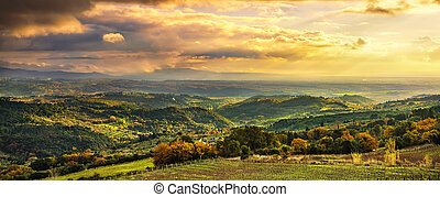 Maremma sunset panorama. Countryside, hills and sea on...