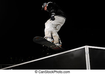 freestyle snowboarder jump - young free style snowboarder...