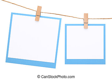 Photo frame hung on rope with clothespin isolated on white...