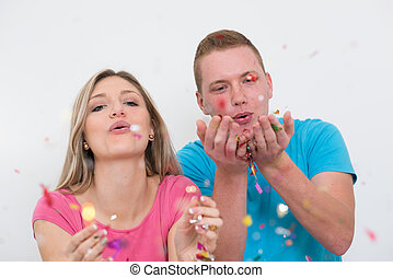 romantic young  couple celebrating  party with confetti