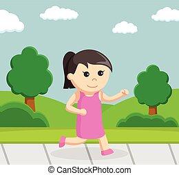 little girl running at park
