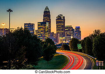 Long exposure of traffic on the Andrew Jackson Highway and view of the Uptown Charlotte skyline at night, from the Central Avenue Bridge, in Charlotte, North Carolina