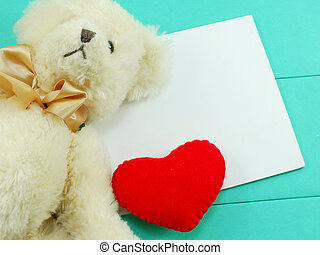 cute teddy bear doll with red heart valentines day on green background