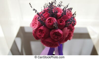 Wedding flowers - bride's bouquet at mirror table