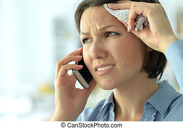 young woman crying in phone, close up
