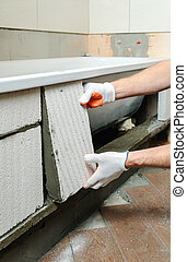 Worker forms the sidebar bath. - Worker places aerocrete...