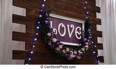 Love inscription on a wooden background, flashing lights and...