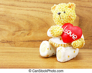 teddy bear doll holding heart shaped with love