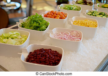 Vegetable ingredients on a salad bar in buffet