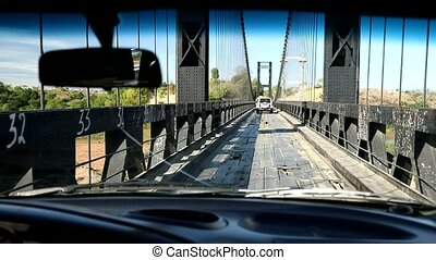 crossing old famous eiffel bridge over madagascar river,...