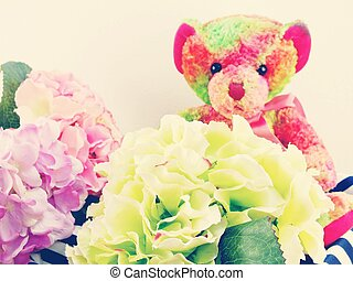 cute teddy bear with gift and beautiful bouquet flower