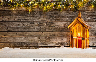 Christmas background with wooden lantern in snow. Copyspace...