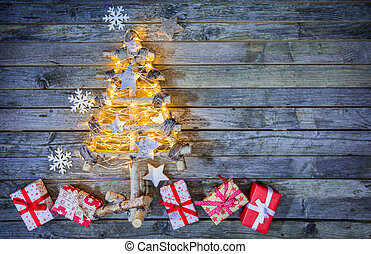 Christmas tree with gifts on wood - Christmas tree with...