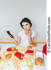 Woman sending kiss at the table with fast food - Cute young...