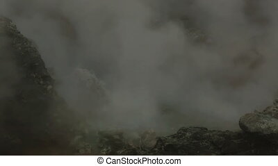 Boiling water in basin of active volcano Mutnovsky stock...