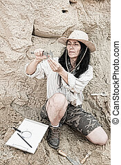 Archeology - researcher determining measurements of an...