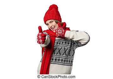 Excited winter warm clothing girl giving double thumb up,...