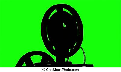 The film turns the projector. Studio green screen silhouette...