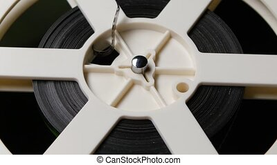 Reel reels off film. Close up - Reel reels off film, retro...