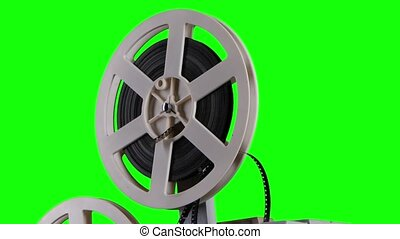 Film is wound onto a cassette projector. Studio green screen...