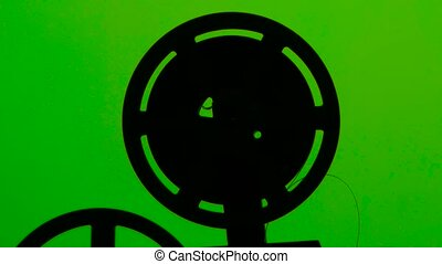 projector film rotates in frame. Studio green screen -...