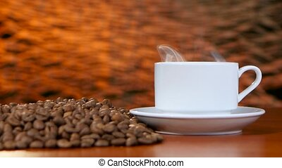 Cup on a white saucer of hot coffee on the aroma spreads...