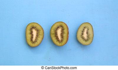 Kiwi fruit on blue background, tasty vegetarian dishes -...
