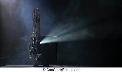 Illuminated projector in a dark room shows movie, the lens...