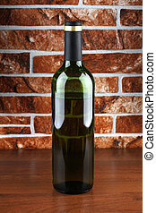 Glass bottle on table - Glass and bottle wine on wooden...
